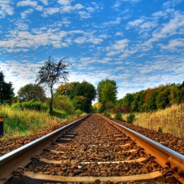 Using a wide-angle lens has increased the diminishing perspective, which makes the lines of the railway track appear to be joining at end. Photograph/John Nyberg.