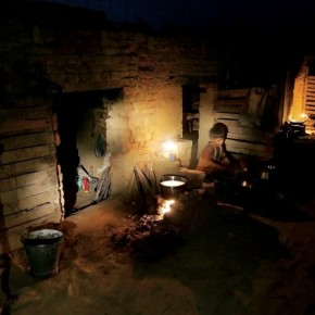 A child prepares food in the evening for his family, who works in a brick kiln near Meerut.. Photograph/Harish Tyagi