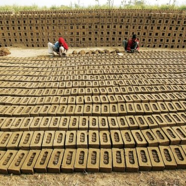 A 14-year-old girl prepares bricks at a brick kiln near Meerut. She and her brother migrated to the city from a nearby state. Photograph/Harish Tyagi