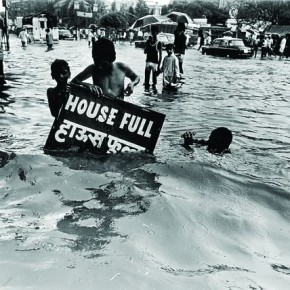 Children hold on to a 'house full' board, as they wade through a flood in Mumbai,1990s. Mukesh believes that photos carrying a humorous undertone can be quite impressive; but equally tough to portray in news. Photograph