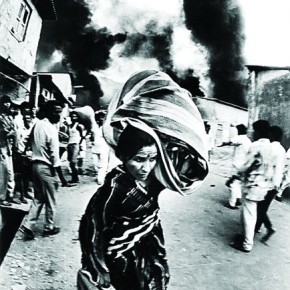A woman flees from a riot-afflicted area . As a responsible photojournalist, Mukesh believes that whatever the situation, the truth must be conveyed without exaggerating it. Photograph/Mukesh Parpiani