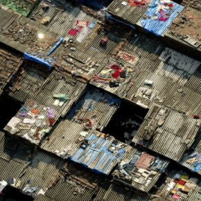 The image shows an expanse of slums seen from the 32nd floor of a plush high-rise building. Photograph/Hari Mahidhar