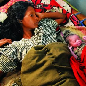 Taramunni Soy and her daughter Helena lie back blissfully just 20 minutes after the delivery in Narangabeda. After three sons, her jobless husband Pasing became obsessed with having a baby girl. Taramunni had to undergo five pregnancies, illegal sex-determination tests and abortions before this little one was allowed to be brought to term. Photograph/Sudharak Olwe