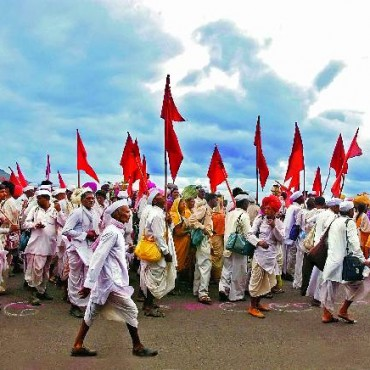 Warkaris reach the top of the Diveghat pass near Pune. The pilgrimage takes place during the monsoons in Maharashtra. If the monsoons are good, the turnout for the pilgrimage is higher than otherwise. Photograph/Shirish Shete