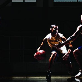 Two basketball players compete on a dramatically lit court. This was for an ad campaign for Reebok. Photograph/Chase Jarvis