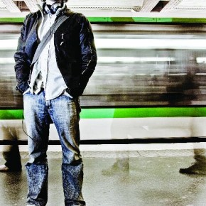 A hip, young man stands in front of a speeding metro train in Paris, France. Photograph/Chase Jarvis