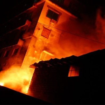 A single window is lit by a fire raging inside. This gives the image an eerie feeling. Photograph/Gireesh G V