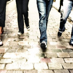 Four friends walk on a cobbled street in the Marais, Paris. Photograph/Chase Jarvis