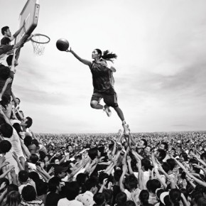 Chinese basketball player Sui Feifei goes for a slam dunk amidst a sea of people. This was shot for the 'Together in 2008, Impossible is Nothing' campaign. Photograph/Mark Zibert