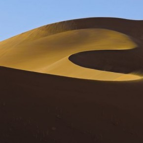 Climbing 'Big Daddy, Sossusvlei, Namibia: This is known as the highest sand dune in the world. Steve waited for the climbers to reach the right point to balance the sweep of the dune and give it a sense of scale. Photograph/Steve Davey