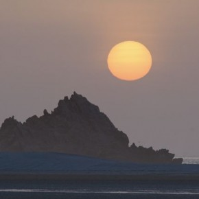 Sunset, Socotra, Yemen: The apparent compression from a telephoto lens was used to make the elements in this picture appear closer together. Photograph/Steve Davey