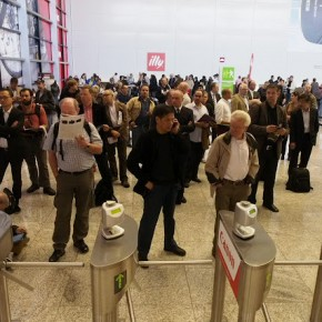 Visitors wait to enter photokina 2012