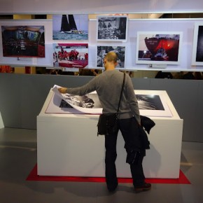 At the Leica stall, a visitor takes a look at a photobook.