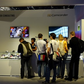 Visitors gather around Panasonic's HD Camcorder stall.