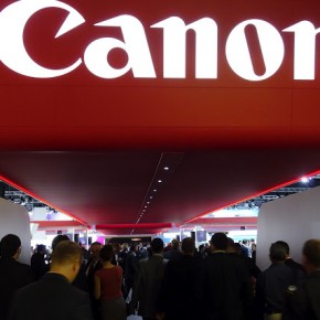 Visitors flock underneath the Canon sign at the fair.