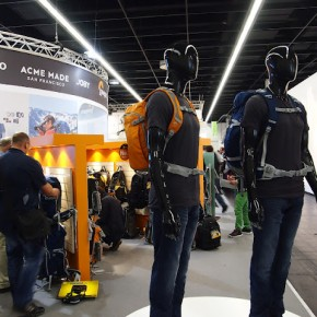 At the Lowepro stall, mannequins display Lowepro camera back packs.