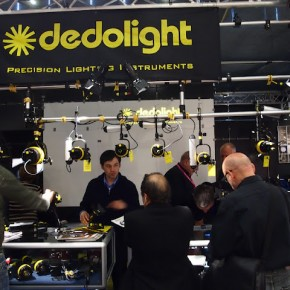 A representative at the Dedolight booth attends to its customers.