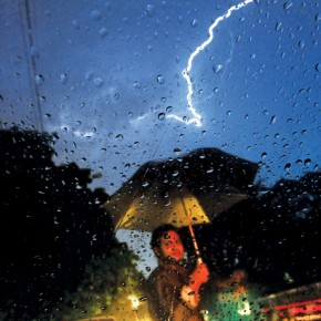 A mix of water droplets, rain gear and phenomena like lightning can convey the extent of rain. Photograph/ S L Shanthkumar