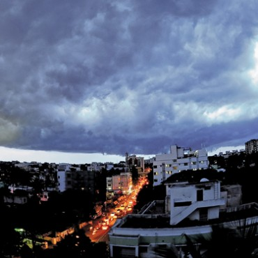 Monsoon presents a gloomy picture of darkness, which in turn, can contrast well with the life of a city. Photograph/S L Shanthkumar