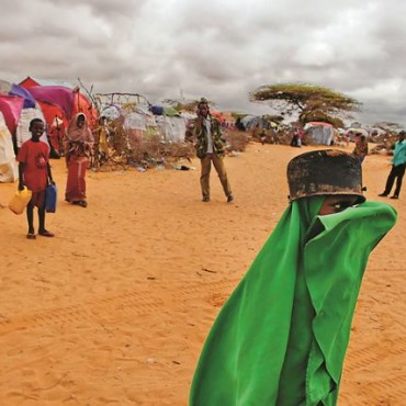 At a camp of homeless Somalian families who lost everything during war, a girl goes to get her food from the WFP (World Food Program). Photograph/Mahdieh Mirhabibi