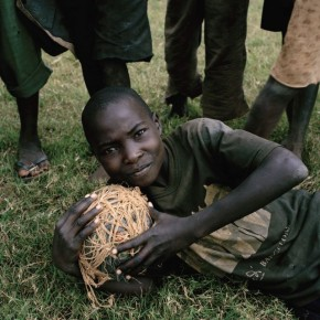 Unknown, outside Pipeline FC, Nhambonda, Mozambique: Making the ball is no simple task. It is a symbol of the inventiveness of poor people everywhere. Photograph/Jessica Hilltout