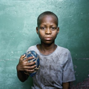 Orlando, Chicome, Mozambique: The sport is the one activity that costs nothing. Balls are made by hand and wood serves for goalposts. Photograph/Jessica Hilltout