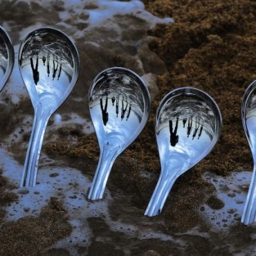 """I was amazed to see the spoons buried in the sand. Even the reflection on these spoons, were inverted. I found this amusing and made a photograph."" Photograph/Sujeet Mhatre"