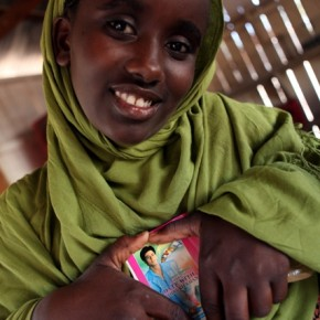 A young Somalian girl who is a huge fan of Shah Rukh Khan, the actor, holds up a CD cover of songs that reads 'A Date with Shah Rukh Khan'. Photograph/Mahdieh Mirhabibi