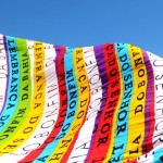 """The beach towel reads """"Reminder of Bahia"""" and is an emblematic souvenir of the city of Salvador. I asked a street vendor to hold it against the wind. Photograph/Alves Filho"""