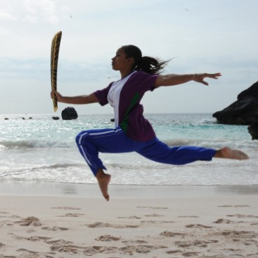 Kaisey Griffith, an eminent gymnast from Bermuda shows her talent with the Queen's Baton for the 2010 Commonwealth Games, Delhi at the Horseshoe Bay beach, Bermuda. Photograph/Debatosh Sengupta