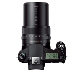The onboard pop-up flash must be opened manually. The LCD display provides important shooting information, and you can illuminate it during low light situations using the back-illumination lamp. The exposure composition dial allows +/- 3EV control.