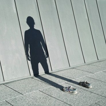 I use my shadow and a pair of running shoes to express an absence within myself. Photograph/Pol Úbeda Hervàs