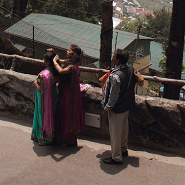 While we go to zoo to observe and learn about animals, it's also interesting to observe ourselves, our habits and social interactions. Here is a typical Indian family on holiday, outside an enclosure in the Darjeeling zoo. May 2014 Photograph/Gopal M S