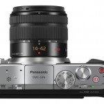 On the top, Panasonic has gone back and reintroduced the Mode Dial on the top. The shutter release button is surrounded by a tele-zoom lever that comes into play when the camera is coupled with power zoom lens. There is no hot shoe.