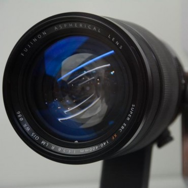 Fujifilm XF 140-400mm f/4-5.6 R LM OIS WR lens on display at photokina. Image Courtesy/Wex Photographic Read more on PhotoRumors.com: http://photorumors.com/2014/09/16/fujifilm-xf-140-400mm-f4-5-6-r-lm-ois-wr-lens-on-display-at-photokina-coming-in-2015/#ixzz3DfE44Cuc