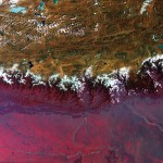You are looking at the very top of the Himalayas. The mountain range also acts as a barrier between the peaks of the Tibetan Plateau and the plains of Nepal, Bhutan and India. The reds in the image symbolise lush green vegetation. Image Courtesy: European Space Agency