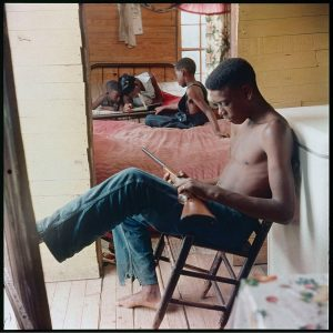Willie Causey, Jr, with Gun During Violence in Alabama, Shady Grove, Alabama, 1956. Photograph/Gordon Parks