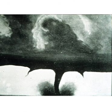 This dramatic picture is the second known image captured of a tornado. On 28th August 1884, as large storm systems converged, tornadoes ripped through Dakota, USA, causing around six deaths and property destruction. Photographer F N Robinson was able to capture two or three exposures of one of the tornadoes. As the tornado approached Howard City, it was visible over the horizon for quite some time, allowing Robinson to set up the cumbersome camera equipment with the help of an assistant. The angry clouds above the funnel were retouched. This was the 1800s and not many people had seen tornadoes, let alone capture pictures of them. Surprisingly, Robinson was not the only person to have photographed the tornado. Another photographer, J C Judkin captured a tintype image of the tornado, but it was lost by the people who were engraving it. Robinson made a souvenir card based on this photograph and copyrighted it, depositing a copy in the Library of Congress. Because of its popularity, this picture is frequently, and incorrectly, credited as the first known photograph of a tornado. The souvenir cards too had this mistake in their captions. There is a tornado photo that was captured four months earlier by A A Adams in the state of Kansas. Adams had captured the tornado just as it was dissipating, is a lot less dramatic and not too well known.