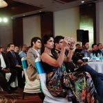 Reshma Gangji from Libas is seen photographing the award ceremony.