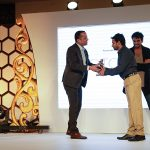 Anill Patil receives his award from Mukul Kashyap, Indian Subcontinent Manager, Lino Manfrotto and Vishal Punjabi, Founder, The Wedding Filmer.