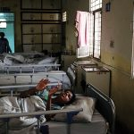 A young woman is seen lying on her bed. IHBAS, formerly known as Shahdara Mental Hospital, has a semi-open ward that caters to long-stay patients. They comprise of those who show psychotic symptoms, and the ones who have recovered, but their families have long forgotten them. Whether partially or fully recovered, these women have now been abandoned for life and continue to live at the institute.
