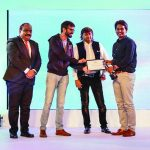 Devan Sarma, Regional Business Head, West, Canon India, Vishal Punjabi, and Vasant Bhandari, Events Head, UB Group present Anupam Maurya (winner Adobe Premier Pro Award for Best Video Editing) with his award.