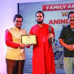 Pritesh Rao and Furqan Khan, Director of the West Zone Cultural Center, Ministry of Culture, present Anindya Phani (winner Family & Friends category) with his award.
