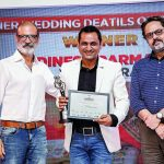 Amit Ashar, Advertising, Editorial & Lifestyle photographer, and Nrupen Madhvani, photographer & filmmaker, present Dinesh Parmar (winner Finer Wedding Details or Still Life category) with his award.