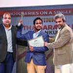 Akash Goel, Sales Manager, Seagate-LaCie, India, and Fawzan Husain, present Partha Sarathi Dalal (winner Photoseries on a Single Wedding category) with his award.