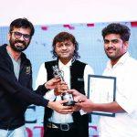 Vishal Punjabi and Vasant Bhandari present Anvesh Varala (winner The Adobe Best Short Wedding Video category) with his award.