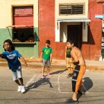 Kids playing a ball game, with squares on the street they call 'efecto', at the Concordia and Escobar streets in Centro Habana, Cuba.
