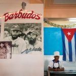 A kitchen worker with a baseball photo of Fidel Castro, at the La Pelola restaurant in Havana, Cuba. Photograph/Ira Block