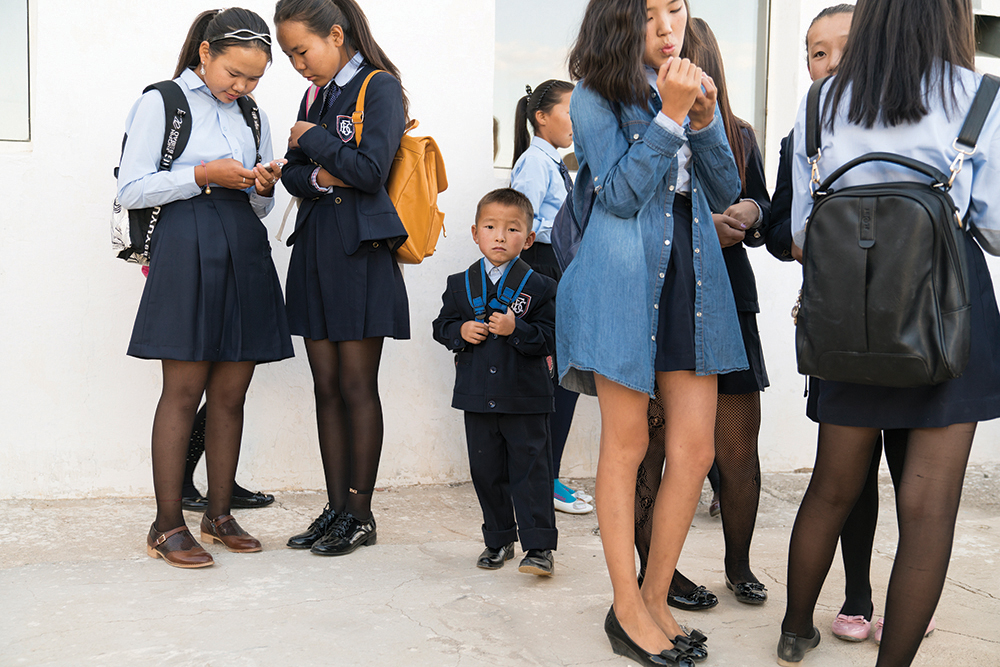 Young students getting ready for the first day of school in the village of Bulgan, in the Ömnögovi Province in the south Gobi Desert in Mongolia. Photograph/Ira Block