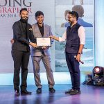 Abhimanyu Sharma, Runner-up of the title of Sony Better Photography Wedding Photographer of the Year 2018-19, receives his award from Prakash Tilokani & Joseph Radhik.